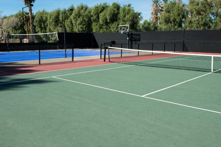 Tennis and basketball courts at The Ranch on a sunny day.