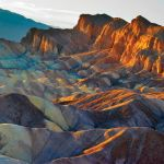 The sun dappled Zabriskie Point at Death Valley National Park.