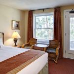 A luxury room with a king size bed and seating area.
