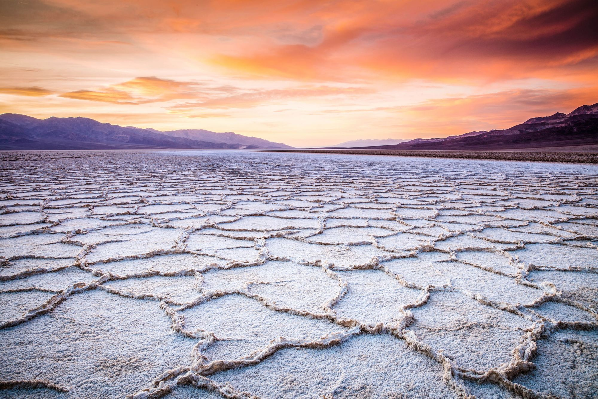 The sunsets over the Badwater landscape in Death Valley National Park.