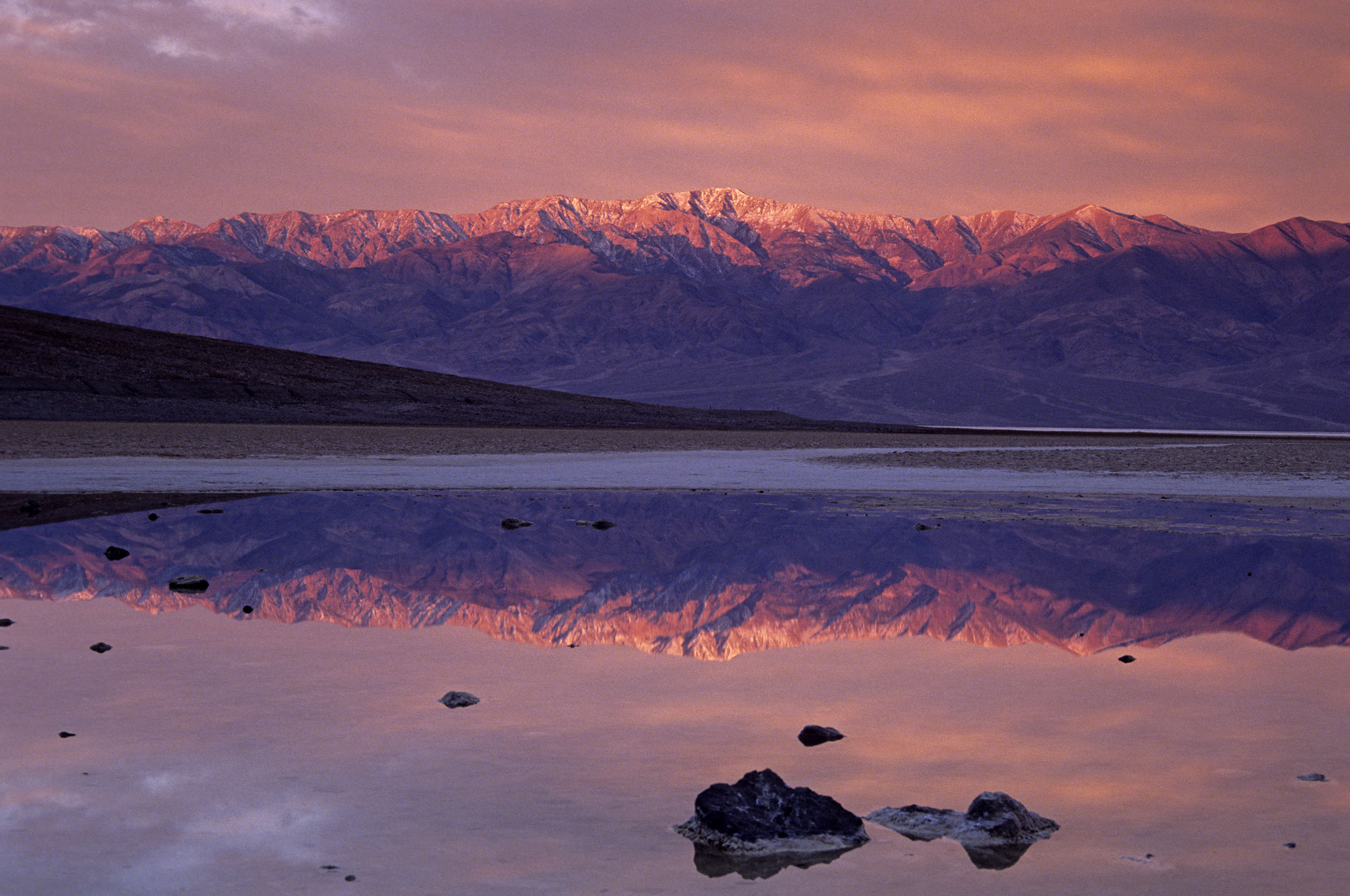 Sunrise colours on Telescope peak reflected in pond at Badwater