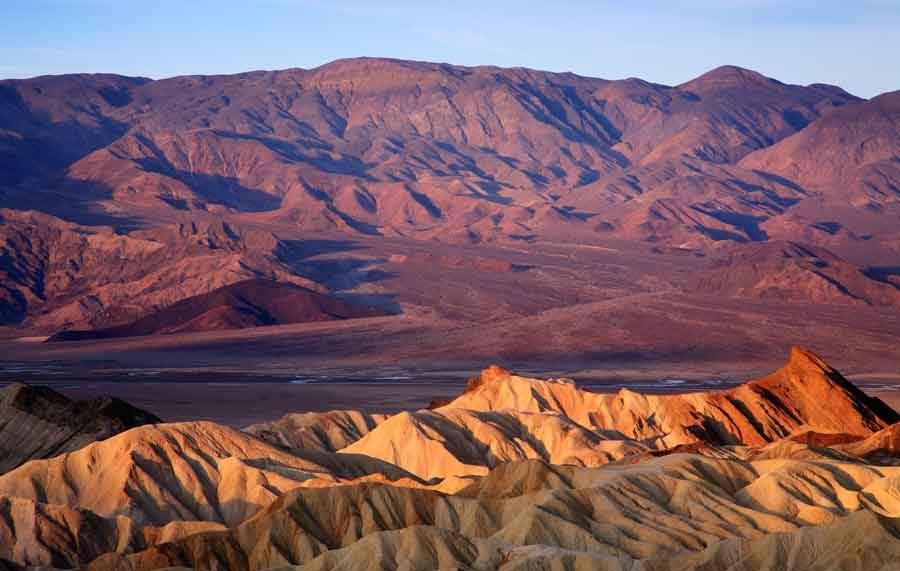 The sun sets over Zabrinski Point in Death Valley National Park.